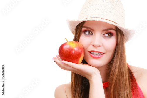 Woman summer hat colorful makeup holds apple fruit