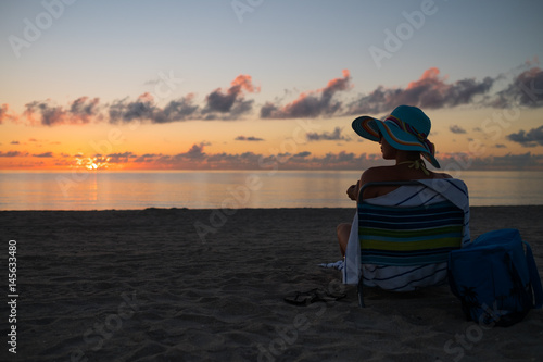Papiers peints Cappuccino Beautiful lady resting alone on a beach on a sunset