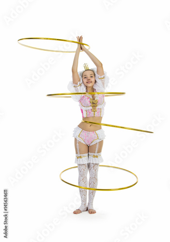 Juliste Gymnast standing twirling a hula hoop