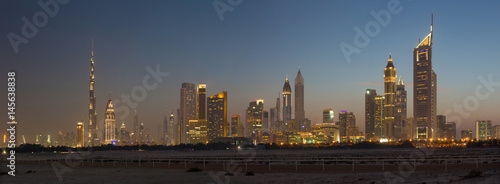 DUBAI, UAE - MARCH 31, 2017: The evening skyline of Downtown with the Burj Khalifa and Emirates Towers.