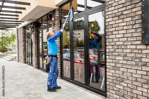 Foto Murales window washer working  at building outdoor