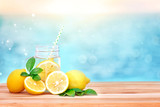 Citrus lemonade water with lemon sliced , healthy and detox water drink in summer on wooden table with blue lighten blur sea background