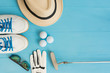 Golf concept : panama hat, glove, golf balls, golf clubs, golf shoes, sunglasses on wooden table. Flat lay with copy space.