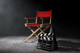 Cinema Industry Concept. Red Director Chair, Movie Clapper and Megaphone in the volumetric light. 3d Rendering - 145672407