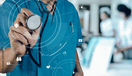 Foto Murales Healthcare and Medicine concept.smart medical doctor working with stethoscope at modern hospital