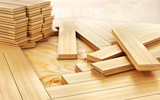 Stack of parquet. Timberwork, lumber work and woodwork industry concept: stacks of wooden timber planks on the wooden floor. 3d illustration - 145724844