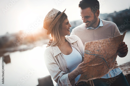 Beautiful couple traveling and sightseeing Poster