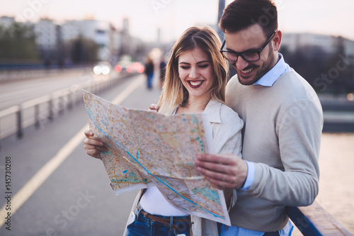 Happy tourists traveling and smiling - 145730208