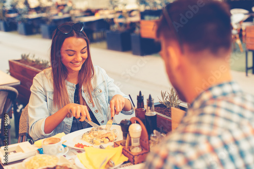 Young couple having lunch at a restaurant