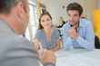 Young couple in meeting with property developer