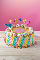 Colourful children's cake decorated with marshmallows and meringues