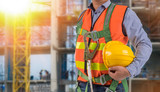 engineer wear fall arrest equipment on site  background