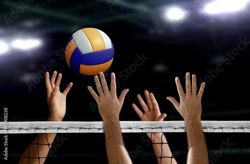 Fototapeta Volleyball spike hand block over the net