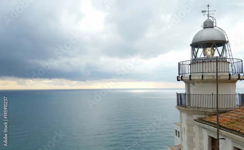 Sea lighthouse on village in Peniscola, Castellon Spain
