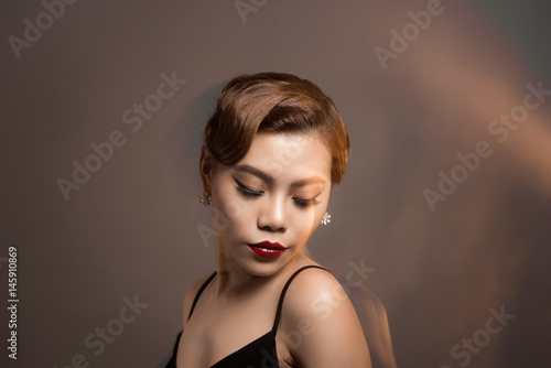 Portrait of a beautiful young woman with brown hair Poster