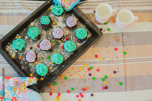 colorful cupcakes are on the tray