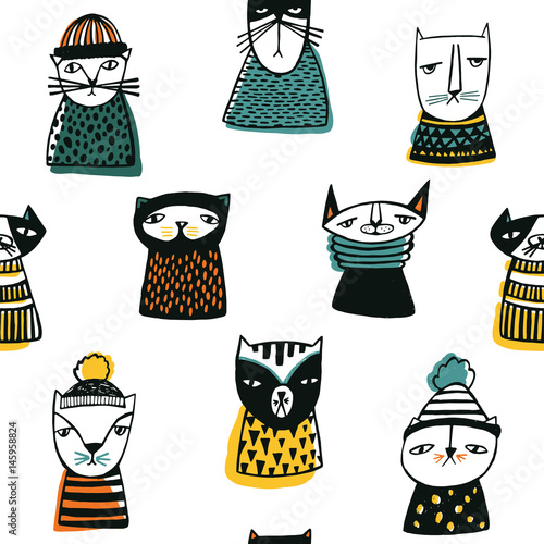 Materiał do szycia Seamless pattern with funny cartoon cats muzzles. Hand drawn doodle kitty on white background.