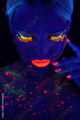 Portrait of Beautiful Fashion Woman in Neon UF Light. Model Girl with Fluorescent Creative Psychedelic MakeUp, Art Design of Female Disco Dancer Model in UV, Colorful Abstract Make-Up - 145960606