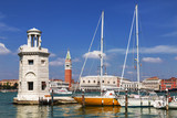 View of the Piazza San Marco, the lighthouse at the island of San Giorgio Maggiore and yachts at berth. Venice. Italy