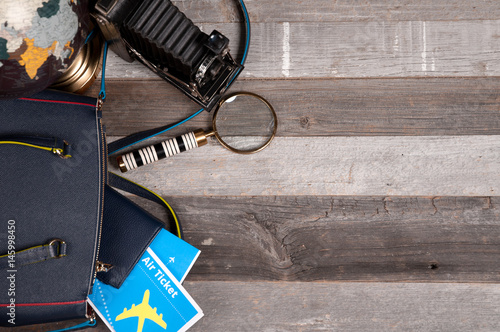Plakat Air ticket, globe  and bag on wood background
