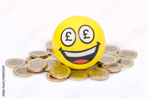 Smiling emoji sitting on top of pile of pound coins, british money Poster