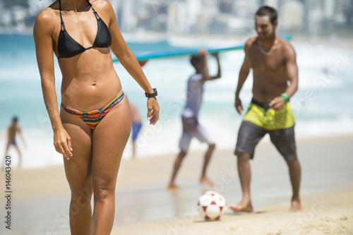 Defocus figures playing sports on the beach in Rio de Janeiro, Brazil