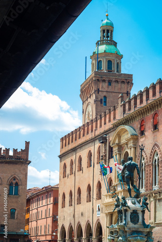 Piazza Maggiore in Bologna old town tower of hall with big clock and blue sky Poster
