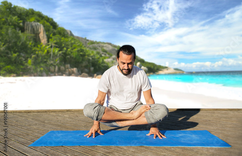 man making yoga in scale pose outdoors Poster