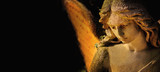 sculpture of an angel with wings against dark background (Religion, faith, Christianity, soul, angel guardian concept) - 146075800
