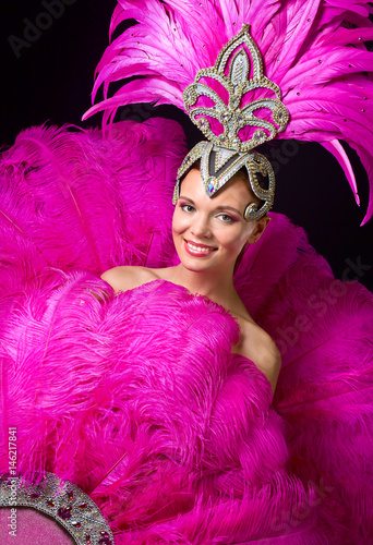 Poster  Beautiful Girl in carnival costume with pink feathers.