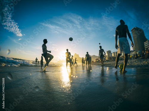 Silhouettes playing beach football on Ipanema Beach in Rio de Janeiro, Brazil Poster