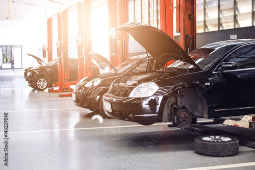 black car repair station with soft-focus in the background and over light