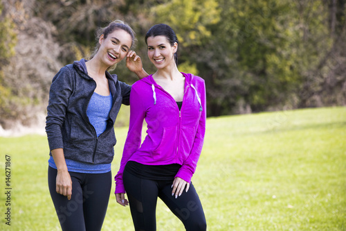 two women wearing active wear in the park