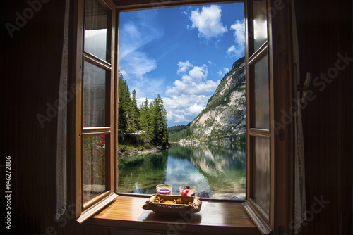 Fototapeta Open window with a view of a mountain lake