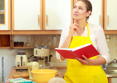 Housewife planning and preparing meal