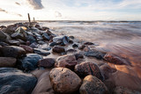 View of a rocky coast beach in the morning.