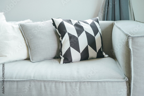 Poster Close up pillows on comfortable sofa in living room