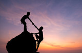 Teamwork couple hiking help each other trust assistance silhouette in mountains, sunset. Teamwork of man to success - 146385230