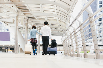 Business finance couple at the airport or convention event .Tourists on vacation waiting their flight to go on excursion