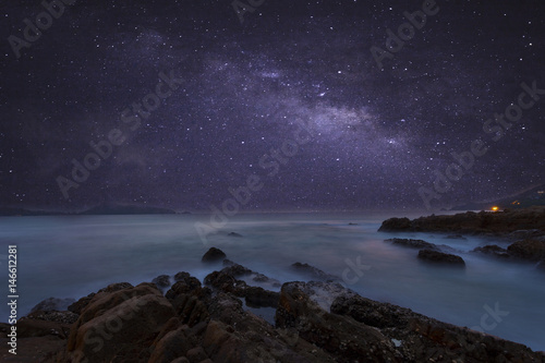 Deurstickers Aubergine milky way galaxy with beautiful seascape long exposure.