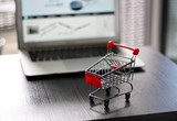 Red Shopping Cart in front of Laptop