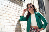 Fototapety Young brunette woman with sunglasses in urban background