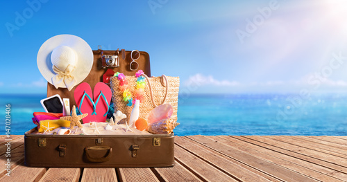Beach Accessories In Suitcase On Beach - Travel Concept  © Romolo Tavani