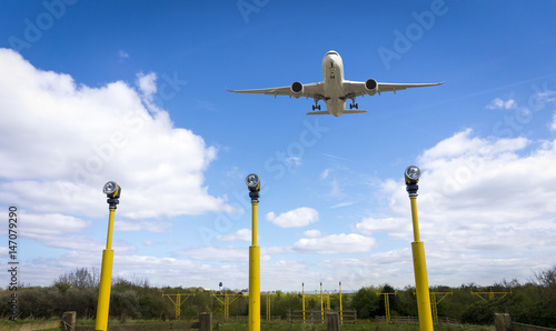 Plane taking off from Manchester Airport over Runway Lights