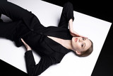 High fashion portrait of young elegant woman in black suit. - 147110297