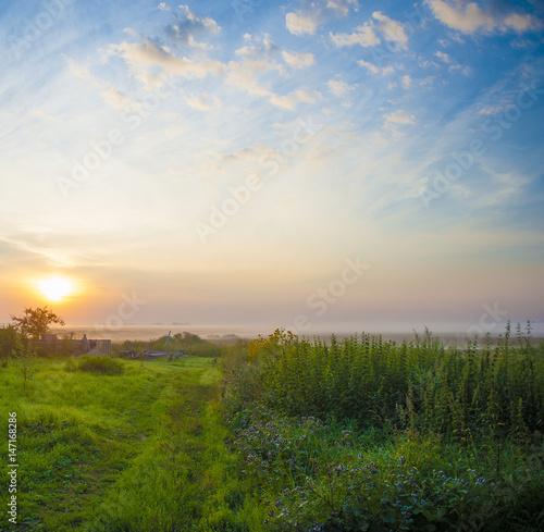 Landscape of foggy sunrise with blue sky Poster