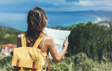 Hipster tourist hold and look map on trip, lifestyle concept adventure, traveler with backpack on background mountain and blue sea landscape horizon, young girl hiker pointing hands on trekking plan - 147225473