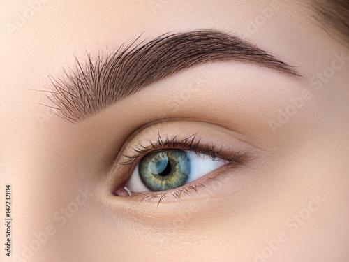 Close up view of beautiful green female eye - 147232814