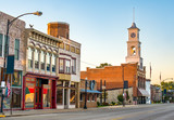 Main street of a quaint, classic small town in midwest America with storefronts and a clock tower - 147315233