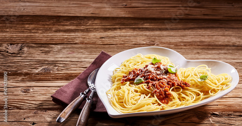 Serving of Italian spaghetti on a rustic table